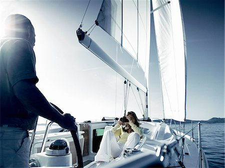 Couple on yacht with camera Stock Photo - Premium Royalty-Free, Code: 614-06442941