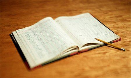 Open account book on wooden desktop Stock Photo - Premium Royalty-Free, Code: 614-06442943
