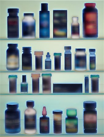 Medicine bottles in cabinet Stock Photo - Premium Royalty-Free, Code: 614-06442953