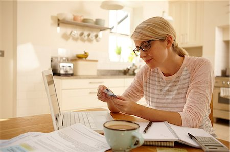 ebusiness - Woman with laptop holding credit card Stock Photo - Premium Royalty-Free, Code: 614-06443019
