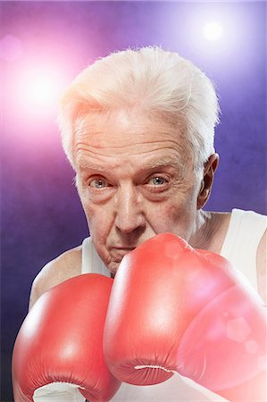 Senior man in boxing gloves Stock Photo - Premium Royalty-Free, Code: 614-06443057