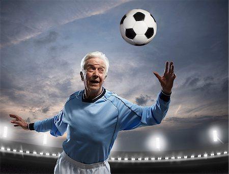 Senior man playing football Stock Photo - Premium Royalty-Free, Code: 614-06443061
