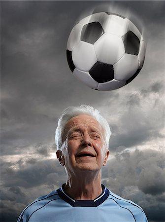 soccer player (male) - Senior man heading football Stock Photo - Premium Royalty-Free, Code: 614-06443062