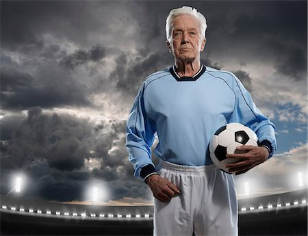 Portrait of a senior male footballer Stock Photo - Premium Royalty-Free, Code: 614-06443063