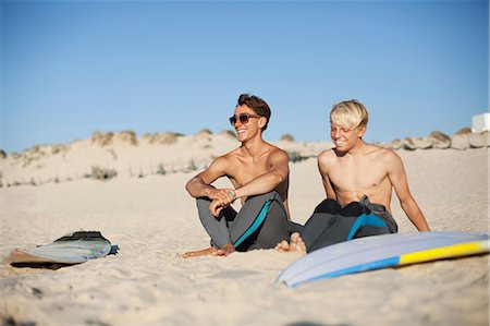 shirtless teen boy - Two young surfers sitting on a beach Stock Photo - Premium Royalty-Free, Code: 614-06443108