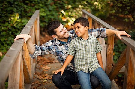 Father and son playing on wooden bridge Stock Photo - Premium Royalty-Free, Code: 614-06536736