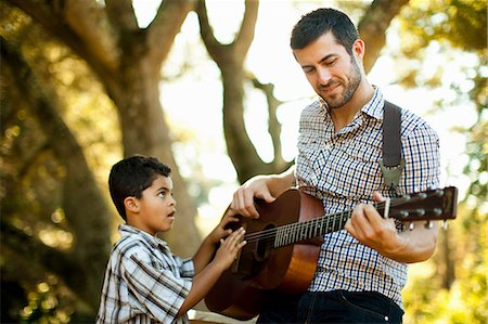 dark hair - Father and son playing guitar together Stock Photo - Premium Royalty-Free, Code: 614-06536732