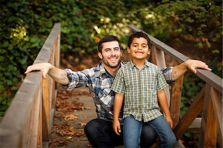 Father and son playing on wooden bridge Stock Photo - Premium Royalty-Free, Code: 614-06536740