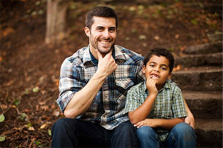 Father and son sitting on stone steps Stock Photo - Premium Royalty-Free, Code: 614-06536743