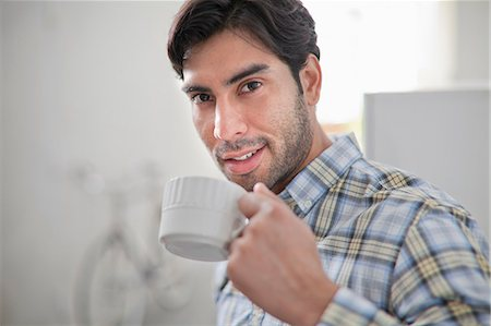 Man drinking cup of coffee in kitchen Stock Photo - Premium Royalty-Free, Code: 614-06536777