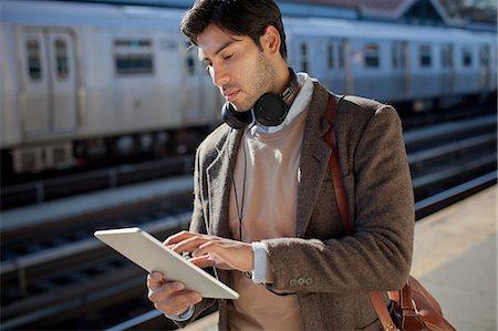 platform - Man using tablet computer at station Stock Photo - Premium Royalty-Free, Code: 614-06536797