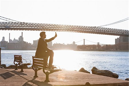 Man taking pictures of urban bridge Stock Photo - Premium Royalty-Free, Code: 614-06536804