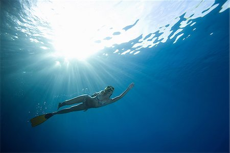 discovery - Woman snorkeling underwater Stock Photo - Premium Royalty-Free, Code: 614-06536838