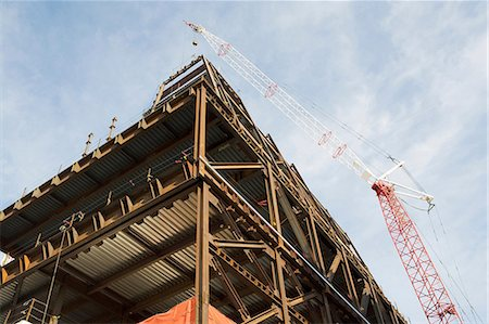 estructura - Crane over building under construction Foto de stock - Sin royalties Premium, Código: 614-06536849