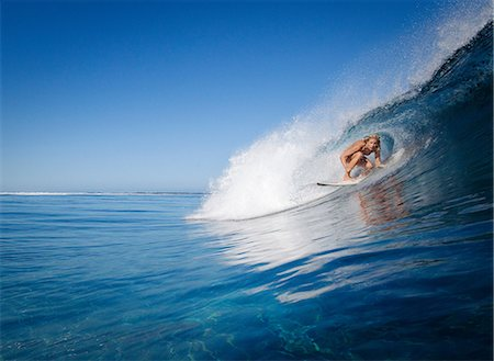 Woman surfing in crest of wave Stock Photo - Premium Royalty-Free, Code: 614-06536883