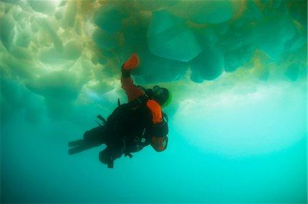 Man scuba diving under glacier Stock Photo - Premium Royalty-Free, Code: 614-06536894