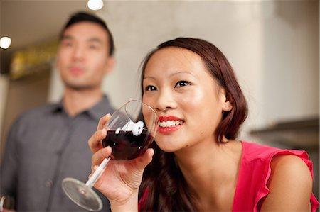 Woman drinking wine in kitchen Stock Photo - Premium Royalty-Free, Code: 614-06536944