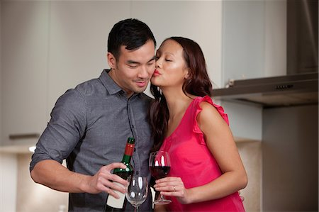 Couple having wine together in kitchen Stock Photo - Premium Royalty-Free, Code: 614-06536941