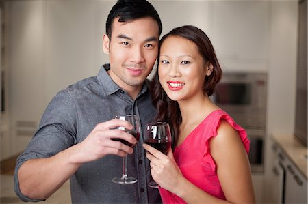 Couple toasting each other with wine Stock Photo - Premium Royalty-Free, Code: 614-06536943