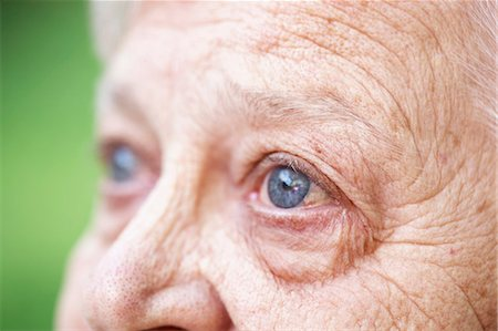Close up of older woman's blue eye Stock Photo - Premium Royalty-Free, Code: 614-06536950