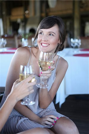 simsearch:400-04222950,k - Women toasting each other with wine Stock Photo - Premium Royalty-Free, Code: 614-06536978