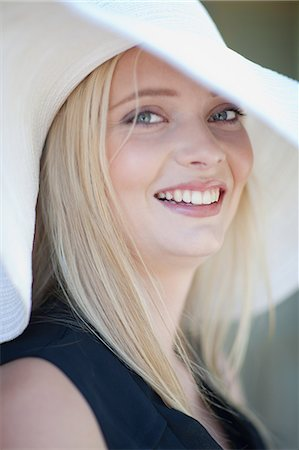 Smiling woman wearing hat Stock Photo - Premium Royalty-Free, Code: 614-06536972