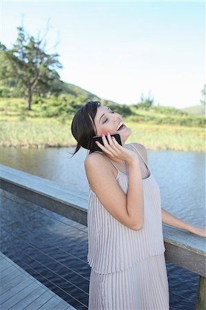 exterior bar - Woman talking on cell phone outdoors Stock Photo - Premium Royalty-Free, Code: 614-06536997