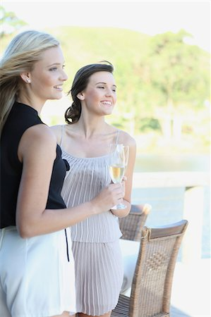 Women drinking wine together outdoors Stock Photo - Premium Royalty-Free, Code: 614-06537003