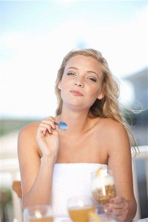 Woman eating breakfast outdoors Stock Photo - Premium Royalty-Free, Code: 614-06537022