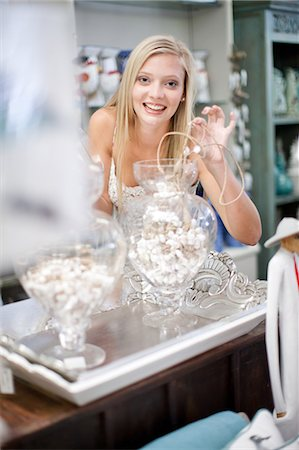 Smiling woman shopping in store Stock Photo - Premium Royalty-Free, Code: 614-06537038