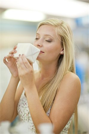 smelling - Woman smelling candle in store Stock Photo - Premium Royalty-Free, Code: 614-06537045