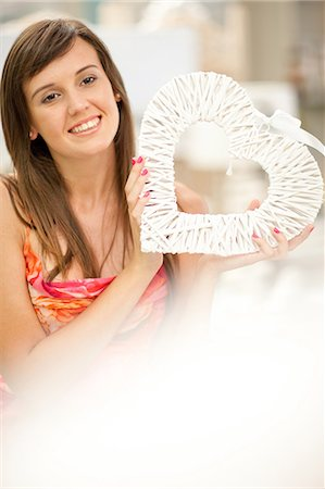 Smiling woman shopping in store Stock Photo - Premium Royalty-Free, Code: 614-06537056