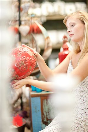 decorations - Smiling woman shopping in store Stock Photo - Premium Royalty-Free, Code: 614-06537064