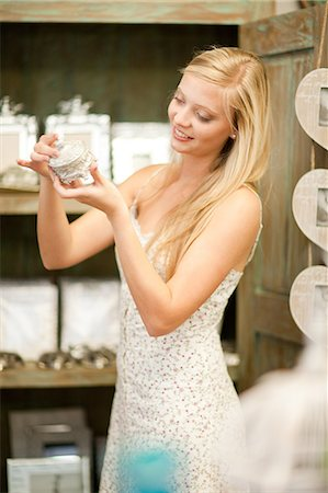 Smiling woman shopping in store Stock Photo - Premium Royalty-Free, Code: 614-06537060