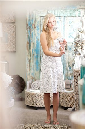 decorations - Smiling woman shopping in store Stock Photo - Premium Royalty-Free, Code: 614-06537073
