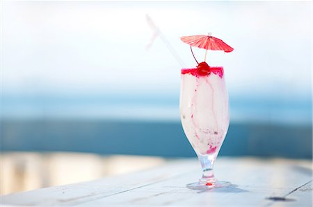 Close up of tropical drink on table Stock Photo - Premium Royalty-Free, Code: 614-06537085