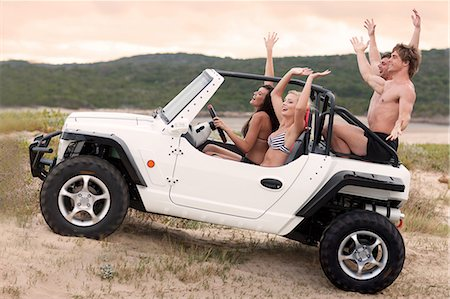 Friends driving jeep on sand dune Stock Photo - Premium Royalty-Free, Code: 614-06537086