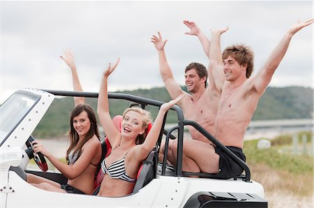 Cheering friends riding in jeep Stock Photo - Premium Royalty-Free, Code: 614-06537095