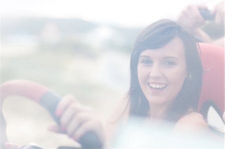 Smiling woman driving jeep Stock Photo - Premium Royalty-Free, Code: 614-06537090