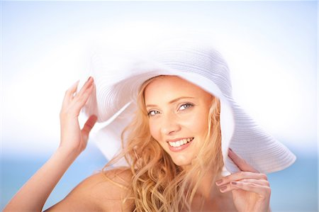 Woman wearing floppy hat outdoors Stock Photo - Premium Royalty-Free, Code: 614-06537108