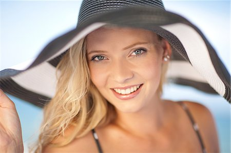 Woman wearing floppy hat outdoors Stock Photo - Premium Royalty-Free, Code: 614-06537122