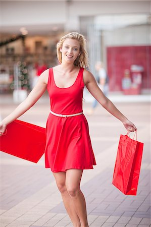 shopping mall - Woman carrying shopping bags in mall Stock Photo - Premium Royalty-Free, Code: 614-06537147