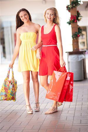 shopping mall - Women carrying shopping bags in mall Stock Photo - Premium Royalty-Free, Code: 614-06537151