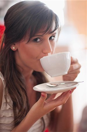Woman drinking coffee in cafe Stock Photo - Premium Royalty-Free, Code: 614-06537175
