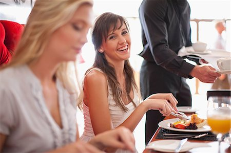 Women having breakfast together in cafe Stock Photo - Premium Royalty-Free, Code: 614-06537171