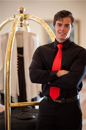 Porter with luggage cart in hotel lobby Stock Photo - Premium Royalty-Free, Code: 614-06537188