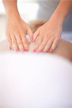 Woman having salt scrub on beach Stock Photo - Premium Royalty-Free, Code: 614-06537202