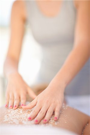 Woman having salt scrub on beach Stock Photo - Premium Royalty-Free, Code: 614-06537203