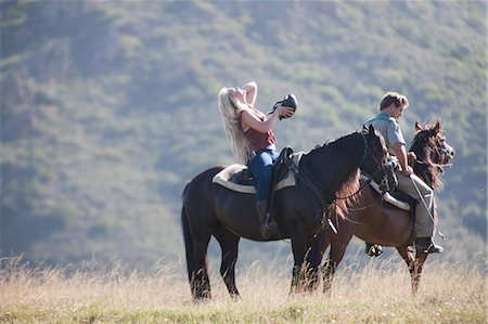Couple riding horses in rural landscape Stock Photo - Premium Royalty-Free, Code: 614-06537224