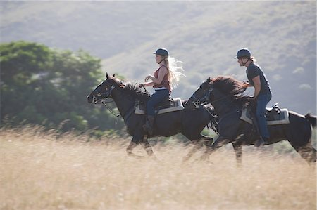 Couple riding horses in rural landscape Stock Photo - Premium Royalty-Free, Code: 614-06537225
